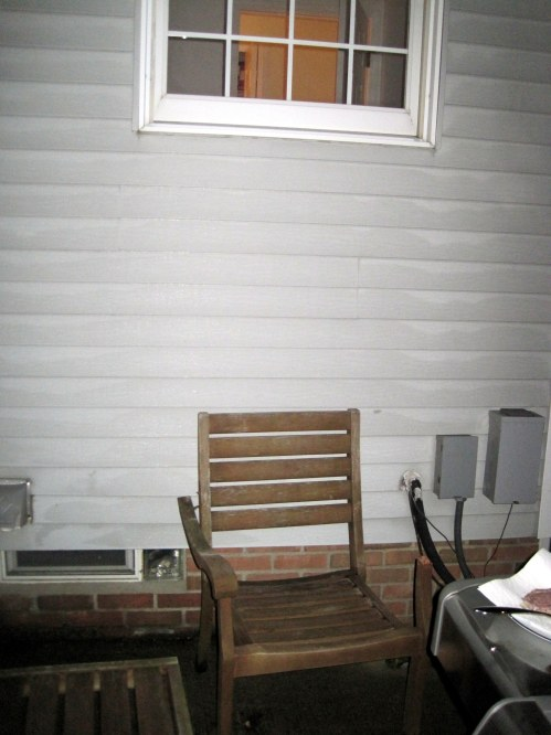 Here, you can see the broken chair and its proximity to the window. The left arm is broken completely off. The left arm is split in two.