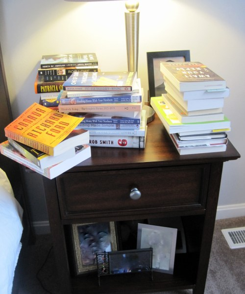 You can't even see the pictures on the nightstand, there are so many books in the way.